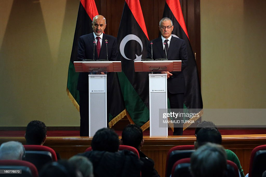 Libyan prime minister Ali Zaidan (R) and Libyan General National Congress president Mohammed Megaryef (L) give a joint press conference on February 5, 2013 in Tripoli, Libya. Two years after the start of the uprising that ousted Moamer Kadhafi, Libya's new rulers are under attack for lack of reforms and face protests on February 15 being touted by some as a 'second revolution'. Faced with growing rumblings in the street, the authorities have put security forces on high alert ahead of the protests as well as celebrations two days later marking the second anniversary of the 'February 17 Revolution' that led to Kadhafi's ouster and being killed in October 2011. TURKIA