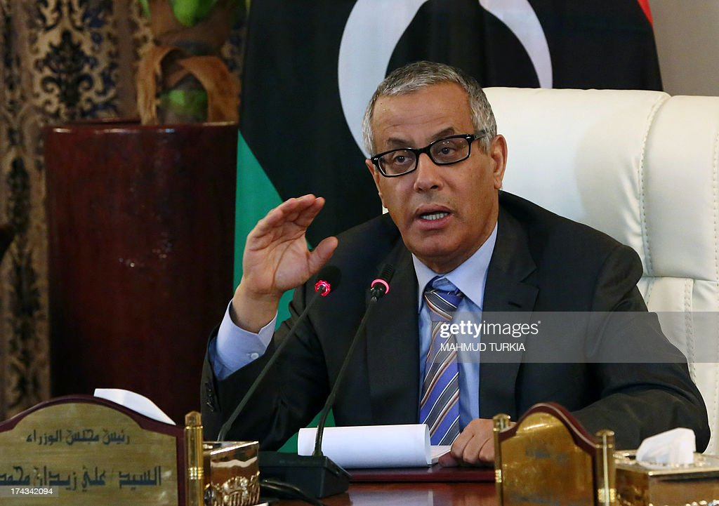 Libyan Prime Minister Ali Zaidan speaks during a press conference with Interior Minister following a rocket attack on a building located in a residential area on July 24, 2013 in Tripoli, Libya. Interior Minister said that the targetted building was the Corinthia hotel where several members of the government, diplomats and foreign businessmen were staying. AFP PHOTO MAHMUD TURKIA
