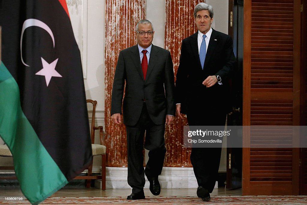 Libyan Prime Minister Ali Zeidan (L) and U.S. Secretary of State <a gi-track='captionPersonalityLinkClicked' href=/galleries/search?phrase=John+Kerry&family=editorial&specificpeople=154885 ng-click='$event.stopPropagation()'>John Kerry</a> arrive for a news conference in between bilateral meetings in the Ben Franklin Room at the State Department on March 13, 2013 in Washington, DC. The two leaders took time in between meetings to make statements to the news media.