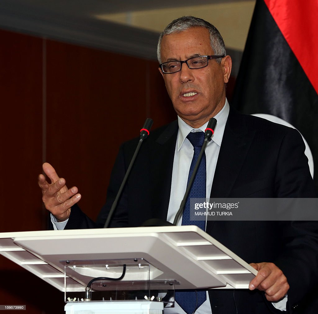 Libyan Prime Minister, Ali Zeidan answers journalist questions in Tripoli, on January 16, 2013, during a press conference concerning the security situation in the city of Benghazi. A car bomb killed a police officer in the Libyan city of Benghazi, an official said, the latest violence to hit the cradle of the 2011 revolt that ousted dictator Moamer Kadhafi. AFP PHOTO / MAHMUD TURKIA