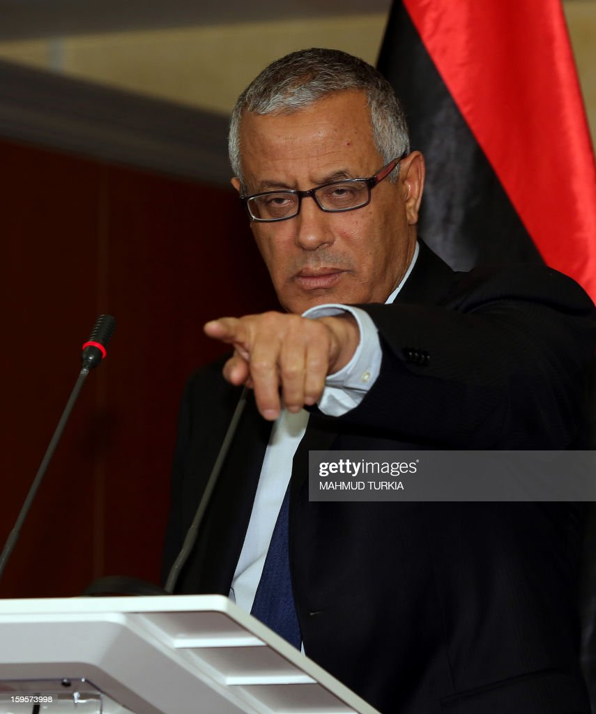 Libyan Prime Minister, Ali Zeidan answers journalist questions in Tripoli, on January 16, 2013, during a press conference concerning the security situation in the city of Benghazi. A car bomb killed a police officer in the Libyan city of Benghazi, an official said, the latest violence to hit the cradle of the 2011 revolt that ousted dictator Moamer Kadhafi.