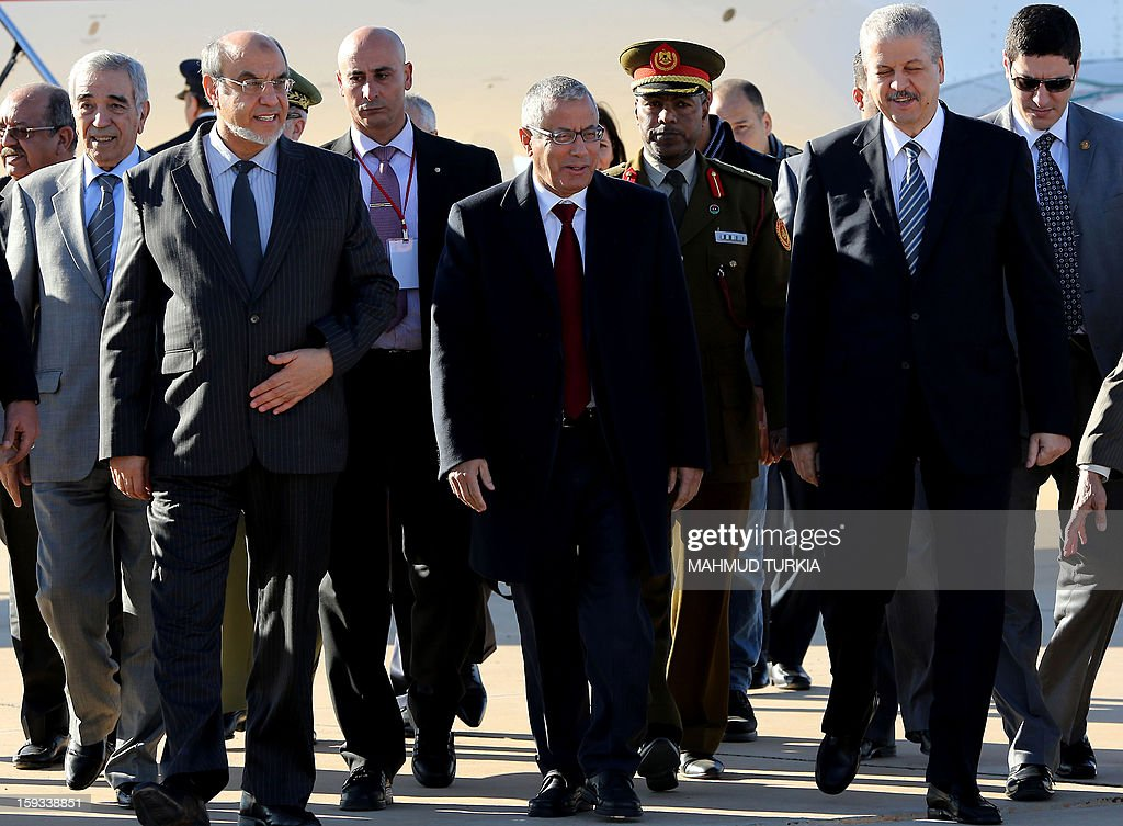 Libyan Prime Minister Ali Zeidan (C) escorts his counterparts Hamadi Jebali of Tunisia (L) and Abdelmalek Sellal of Algeria (R) upon arrival at Ghadames airport to hold a three-way summit on January 12, 2013. The premiers of Algeria, Libya and Tunisia are meeting in the Libyan oasis of Ghadames to discuss security along their common borders. AFP PHOTO/MAHMUD TURKIA