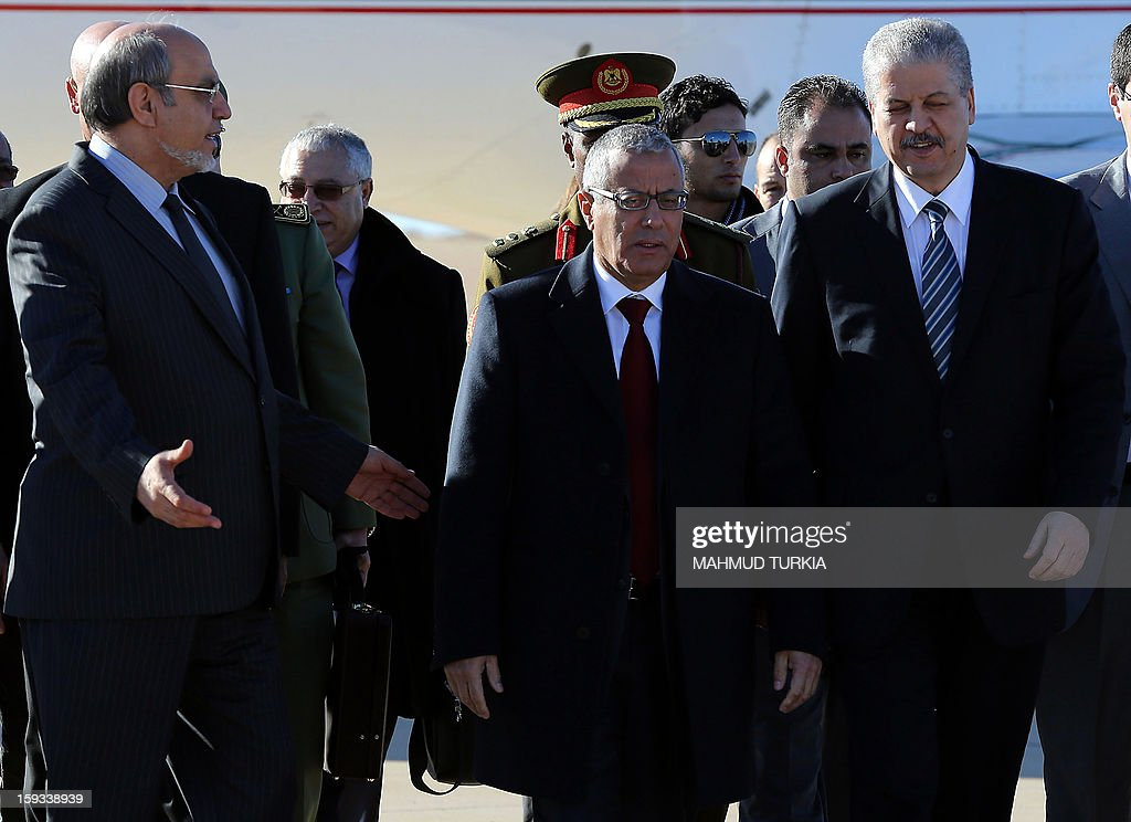 Libyan Prime Minister Ali Zeidan (C) escorts his counterparts Hamadi Jebali of Tunisia (L) and Abdelmalek Sellal of Algeria (R) upon arrival at Ghadames airport to hold a three-way summit on January 12, 2013. The premiers of Algeria, Libya and Tunisia are meeting in the Libyan oasis of Ghadames to discuss security along their common borders.