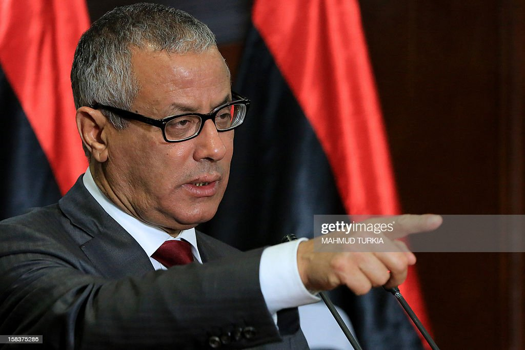 Libyan Prime Minister <a gi-track='captionPersonalityLinkClicked' href=/galleries/search?phrase=Ali+Zeidan&family=editorial&specificpeople=7544817 ng-click='$event.stopPropagation()'>Ali Zeidan</a> gestures as he gives a press conference on December 14, 2012 in Tripoli, Libya. Zeidan called for a meeting to secure regional borders, as slain dictator Moamer Kadhafi's son shelters in Niger. AFP PHOTO/MAHMUD TURKIA