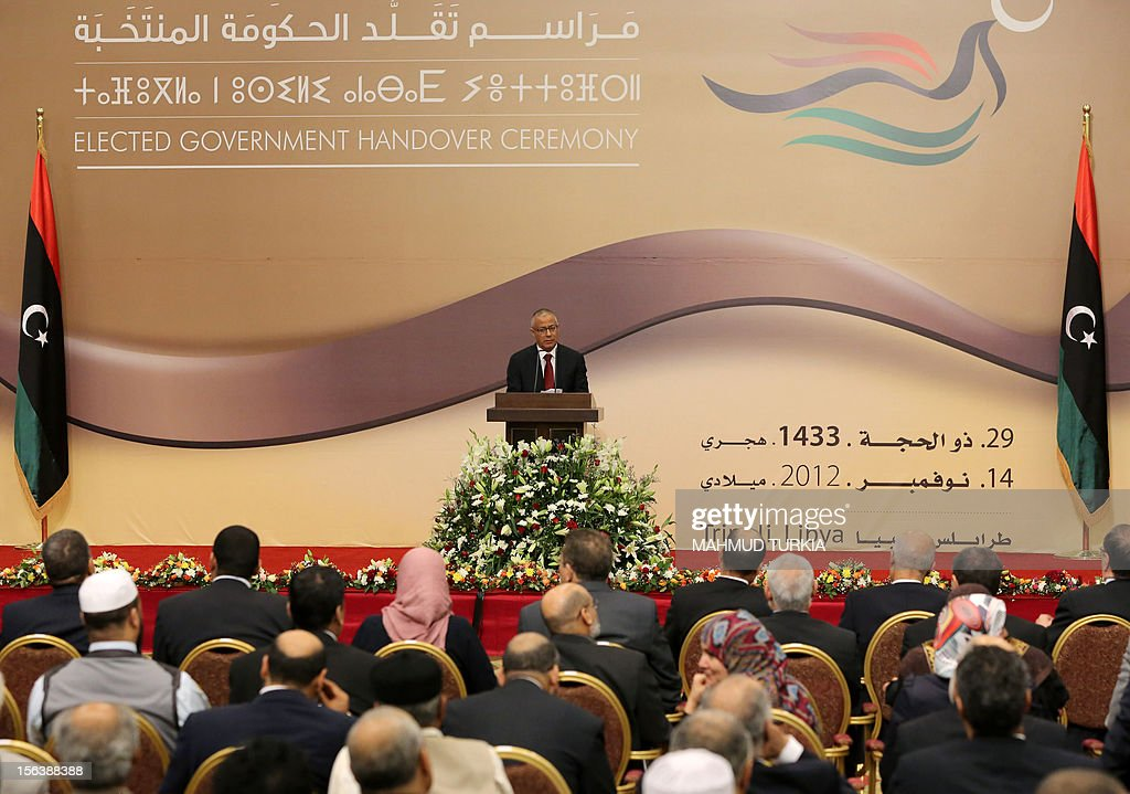 Libyan Prime Minister Ali Zeidan gives a speech during a handover ceremony in Tripoli, on November 14, 2012, after his new cabinet was sworn in following public demonstrations against some of its members. AFP PHOTO/MAHMUD TURKIA