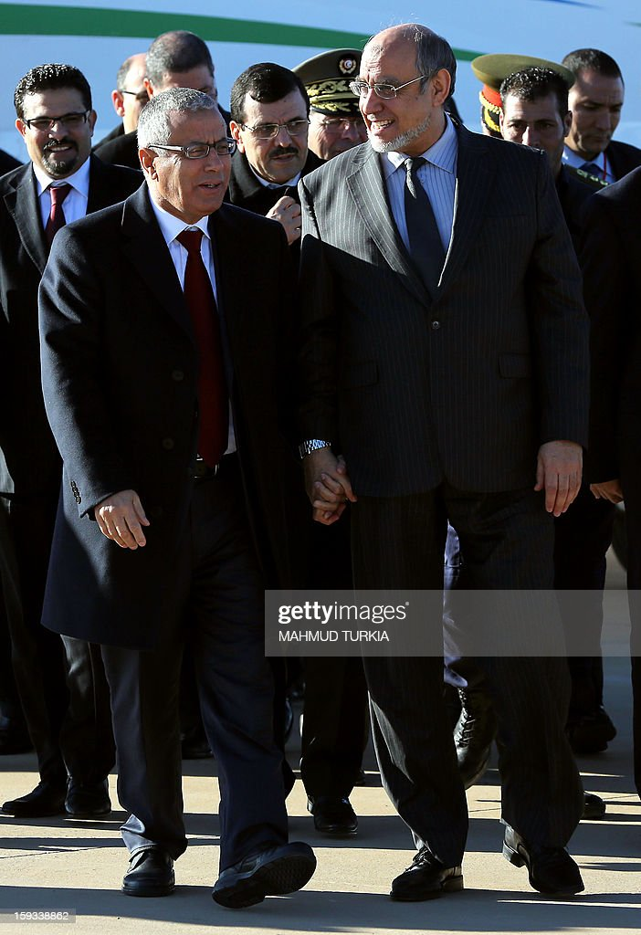 Libyan Prime Minister Ali Zeidan (L) greets his Tunisian counterpart Hamadi Jebali upon arrival at Ghadames airport on January 12, 2013. The premiers of Algeria, Libya and Tunisia are meeting in the Libyan oasis of Ghadames to discuss security along their common borders.