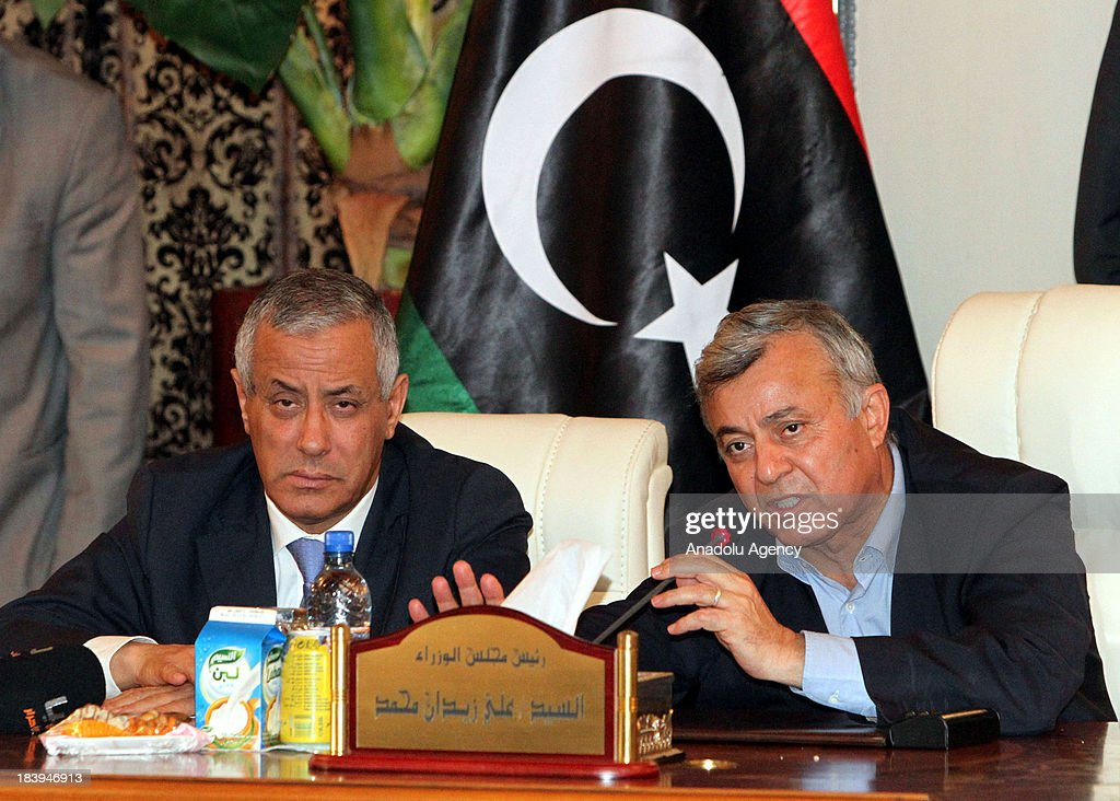 Libyan Prime Minister <a gi-track='captionPersonalityLinkClicked' href=/galleries/search?phrase=Ali+Zeidan&family=editorial&specificpeople=7544817 ng-click='$event.stopPropagation()'>Ali Zeidan</a> (L) holds a press conference after he was released on October 10, 2013 in Tripoli, Libya. Zeidan was kidnapped earlier today by unidentified persons from a hotel in Tripoli.