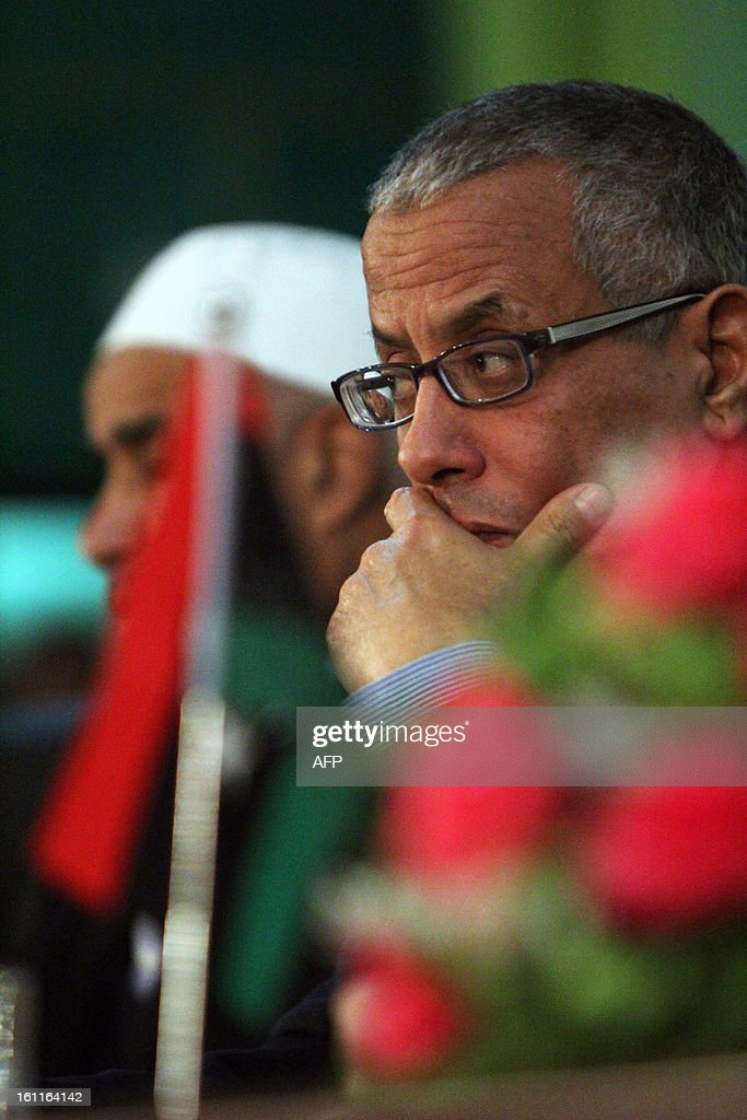 Libyan Prime Minister Ali Zeidan (R) listens on during a meeting with local council representative and Benghazi officers in the eastern coastal city of Benghazi on February 8, 2013.