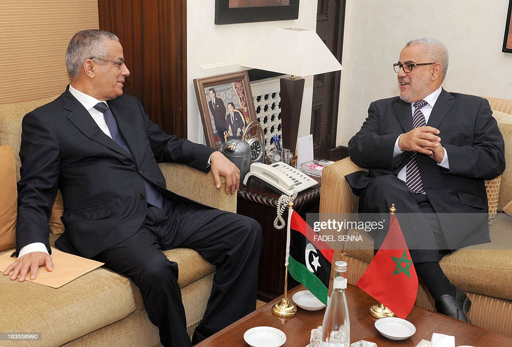 Libyan Prime Minister <a gi-track='captionPersonalityLinkClicked' href=/galleries/search?phrase=Ali+Zeidan&family=editorial&specificpeople=7544817 ng-click='$event.stopPropagation()'>Ali Zeidan</a> (L) meets with Moroccan Prime Minister (R) Abdelilah Benkirane on October 7, 2013 in Rabat during the former's three day visit to Morocco. AFP PHOTO /FADEL SENNA