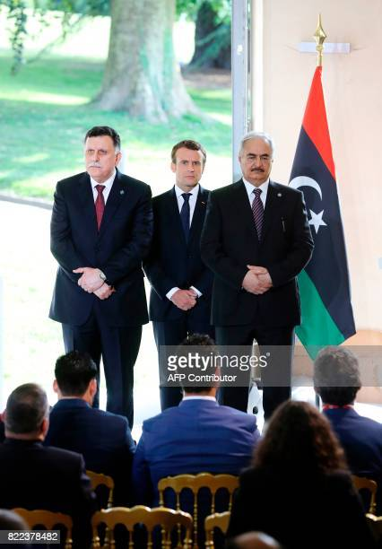 Libyan Prime Minister Fayez alSarraj French President Emmanuel Macron and General Khalifa Haftar commander in the Libyan National Army attend a press...