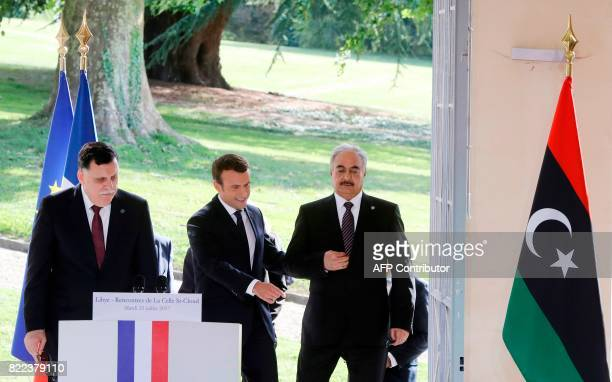 Libyan Prime Minister Fayez alSarraj French President Emmanuel Macron and General Khalifa Haftar commander in the Libyan National Army arrive for a...