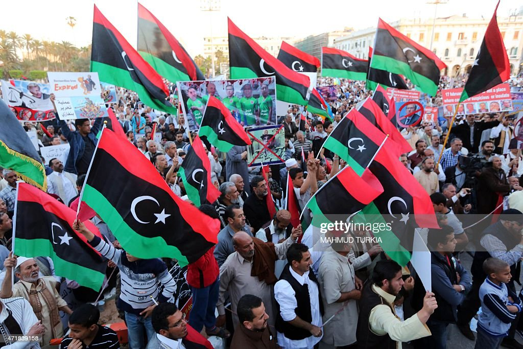 Libyan protesters take part in a demonstration in downtown Tripoli on May 1 in support of the Supreme Court which invalidated in 2014 the elected...
