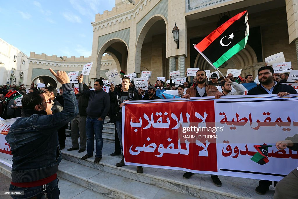 Libyan protestors gather to show their support to the General National Congress the country's highest political authority in Tripoli's Algeria square...
