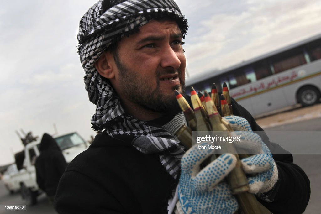 A Libyan rebel carries anti-aircraft ammunition at a checkpoint on March 10, 2011 in Ras Lanuf, Libya. Most rebel forces fled the Ras Lanuf as government forces loyal to Libyan leader Moammar Gaddafi attacked them with heavy shelling and airstrikes.