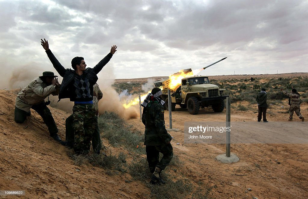 Libyan rebels fire rockets at government troops on the frontline on March 9, 2011 near Ras Lanuf, Libya. The rebels pushed back government troops loyal to Libyan leader Muammar Gaddafi towards Ben Jawat.