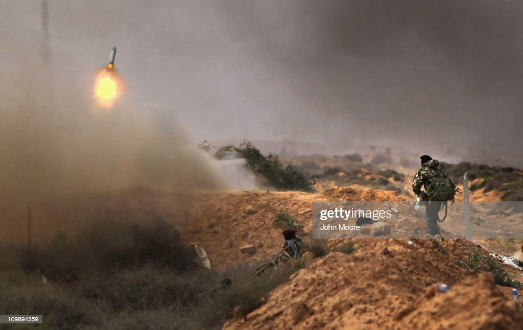 Libyan rebels fire rockets at government troops on the frontline on March 9, 2011 near Ras Lanuf, Libya. The rebels pushed back government troops loyal to Libyan leader Muammar Gaddafi westward towards Ben Jawat.