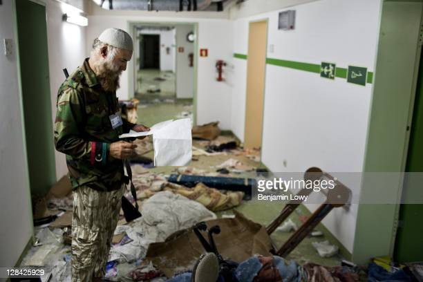 Libyan rebels tour the massive underground hospital complex that streches across the compound belonging to AlMu'tasimBillah alGaddafi a son of the...