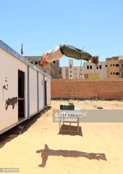 A Libyan recruit takes part in military training at a centre in Gharyan some 80 kilometres south of the capital Tripoli on July 11 2017 In the past...