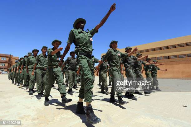 Libyan recruits march during military training at a centre in Gharyan some 80 kilometres south of the capital Tripoli on July 11 2017 In the past few...