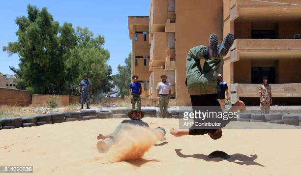 Libyan recruits take part in military training at a centre in Gharyan some 80 kilometres south of the capital Tripoli on July 11 2017 In the past few...