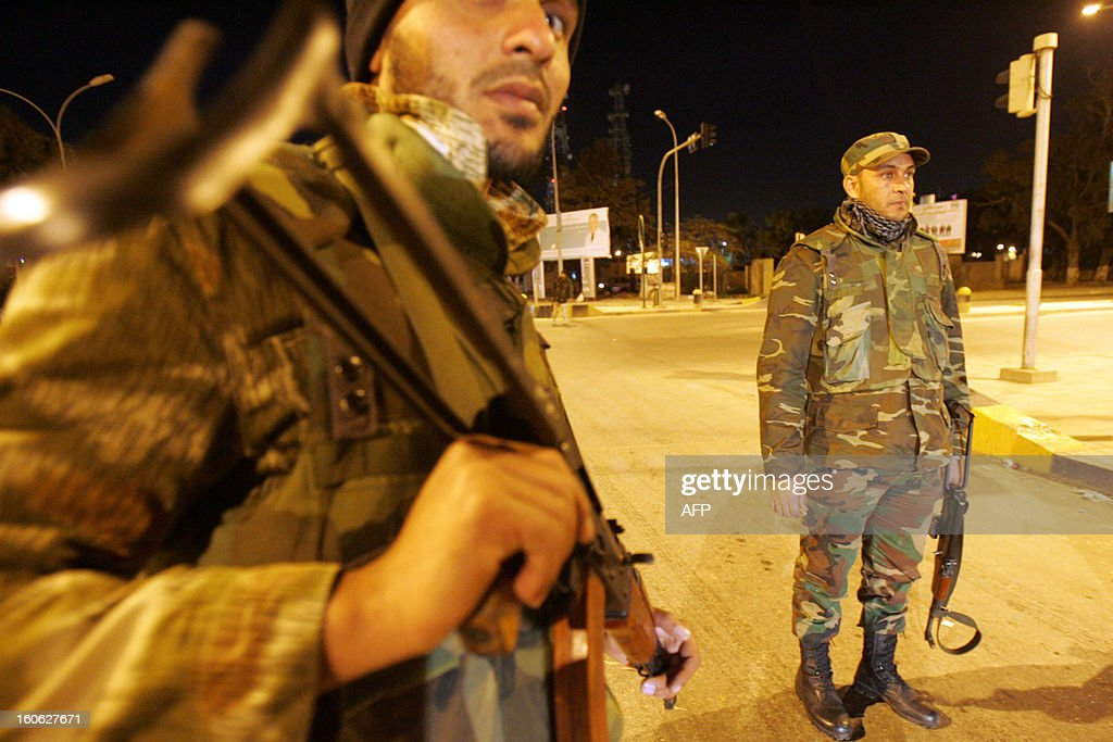 Libyan security are seen at an intersection in the eastern city of Benghazi on February 3, 2013, as they take part in a joint security operation launched by the Defence and Interior ministries. Two years after the 'revolution' that toppled dictator Moamer Kadhafi, the Libyan authorities have been criticized for their inability to reform, and some are calling for demonstrations that are being tagged a 'second revolution.'