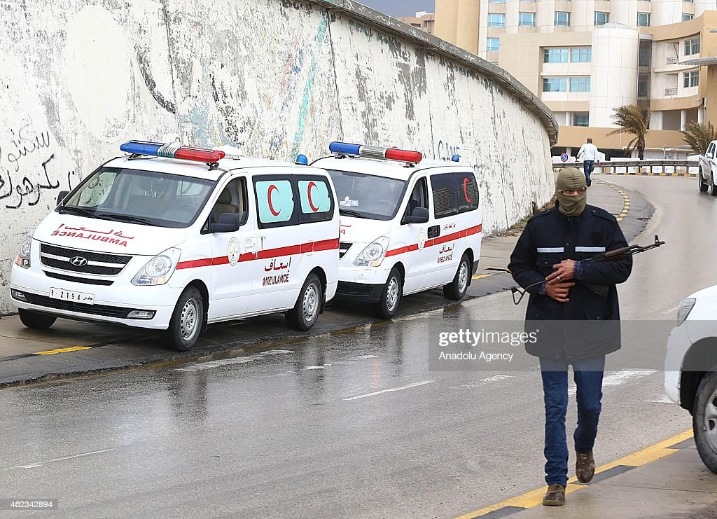 Libyan security forces and emergency services surround the Corinthia Hotel on January 27 2015 after a car bomb exploded outside the largest hotel in...