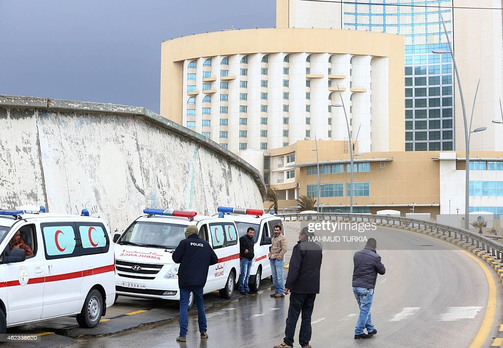 Libyan security forces and emergency services surround Tripoli's central Corinthia Hotel on January 27 2015 in the Libyan capital The hotel was...