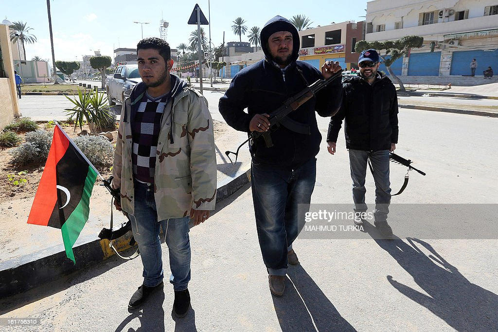 Libyan security forces members patrol the streets near the Martyrs square, two days ahead of the second anniversary of the uprising that toppled the regime of strongman Moamer Kadhafi on February 15, 2013 in Tripoli. The government has already taken a series of measures to contain any attempt by supporters of the former regime to 'sow chaos' amid anger from protesters who accuse the new rulers of failing to push for reform.