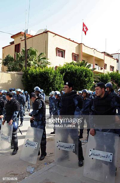 Libyan security forces stand guard outside the Swiss embassy in Tripoli during a protest on March 1 2010 in support of Libyan leader Moamer Kadhafi's...