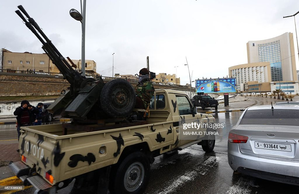 Libyan security forces surround Tripoli's central Corinthia Hotel on January 27 2015 in the Libyan capital The hotel was reportedly attacked by...