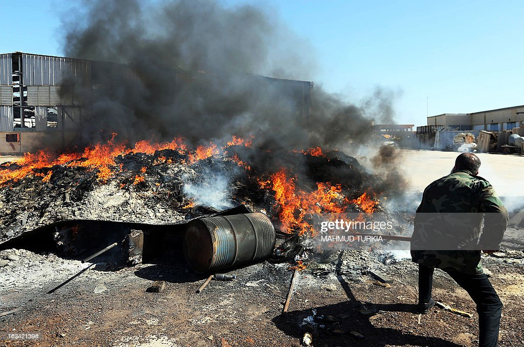 A Libyan security officer supervises the incineration of 30 tons of hashish on February 23, 2013 in the capital, Tripoli. The border between Libya and Tunisia has become an increasingly popular passageway for drugs and contraband following the fall of dictator Moamer Kadhafi, last year. AFP PHOTO/MAHMUD TURKIA
