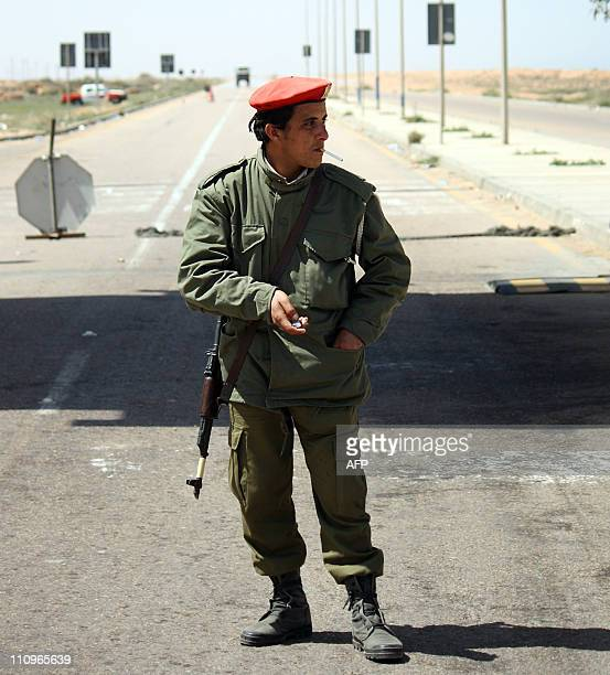 A Libyan soldier of Moamer Kadahfi's son Khamis Battalion is pictured at a check point some 50 kms from Sirte on the way to Tripoli on March 28 2011...