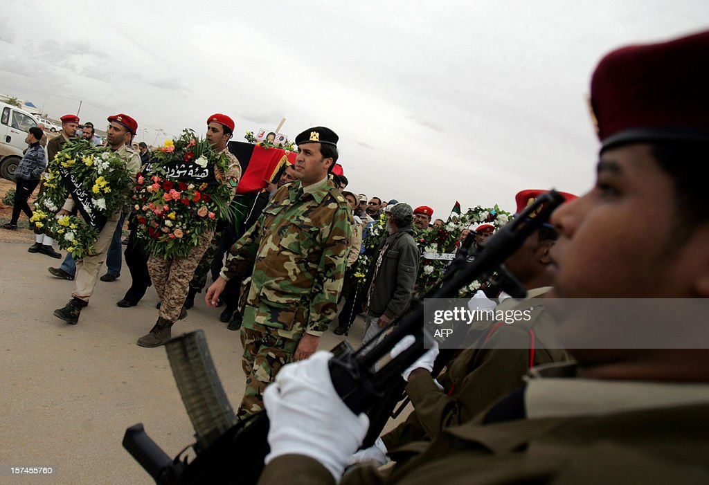 Libyan soldiers carry the coffin of leading Libyan dissident Mansour al-Kikhia during his funeral procession in the eastern Libyan port city of Benghazi on December 3, 2012. Kikhia, who disappeared 19 years ago under the Kadhafi regime, was buried weeks after his body was found in an intelligence services morgue, his brother said. AFP PHOTO / ABDULLAH DOMA