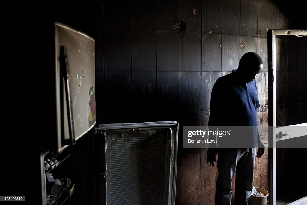 A Libyan stands in the destroyed remains of an apartment kitchen in a building targeted by Rebel forces during a violent confrontation with Gaddafi loyalists in the Abu Salim neighborhood on August 30 2011 in Tripoli, Libya.