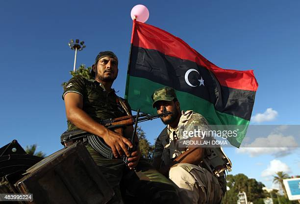 Libyan troops loyal to Khalifa Haftar a retired general and former chief of staff for Moamer Kadhafi sit on an amoured personnel carrier during a...