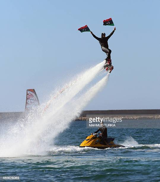 A Libyan using a water jetpack takes part in a local windsurfing competition in the capital Tripoli on April 19 2014 AFP PHOTO/MAHMUD TURKIA