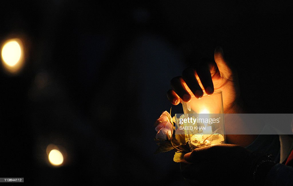 A Libyan woman holds a candle during a candlelight vigil to show solidarity with the people of Misrata and Tripoli in the rebel stronghold of...