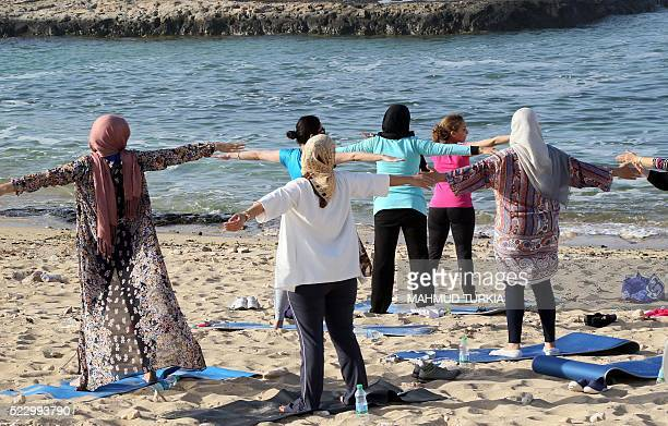 Libyan women take part in a seaside yoga session at a secluded beach in the Libyan capital Tripoli on April 14 2016 For many Libyan women who enjoy...