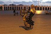 A Libyan youth performs stunts on a scooter in the square of the eastern coastal city of Benghazi on February 1 2016 during a festival organised by...