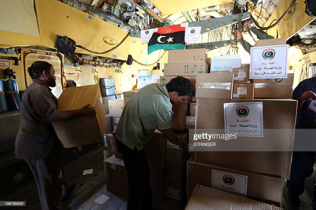 Libyana load humanitarian aid onto a Libyan cargo plane to be delivered to Gaza at Mitiga Airport in Tripoli, on November 20, 2012. A group of 38 aid agencies urged the international community to take action to secure a ceasefire in Gaza to prevent 'another widespread humanitarian disaster.'