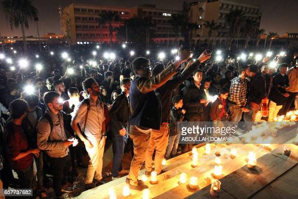 Libyans attend a candlelit concert marking 'Earth Hour' in the eastern coastal city of Benghazi on March 25 as iconic landmarks and skylines are...