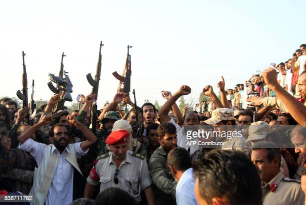 Libyans attend a funeral in city of Surman some 80 kilometres west of Tripoli on August 24 of some of the people that were beheaded the previous day...