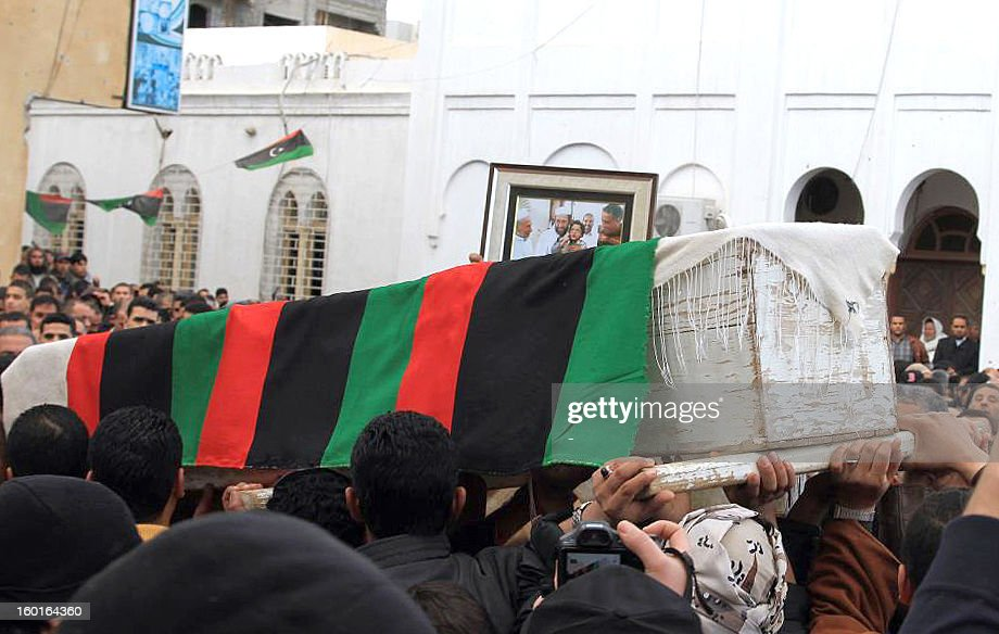 Libyans carry the coffin of Sheikh Mohamed bin Othman, a Muslim Brotherhood official and member of the local council from Misrata, during his funeral in this port city in east Libya, on January 27, 2013. Othman, shot dead as he left a mosque, was a former political prisoner under the regime of Moamer Kadhafi and a founding member of the Justice and Construction Party, which was launched by the Brotherhood in Libya. AFP PHOTO/STR