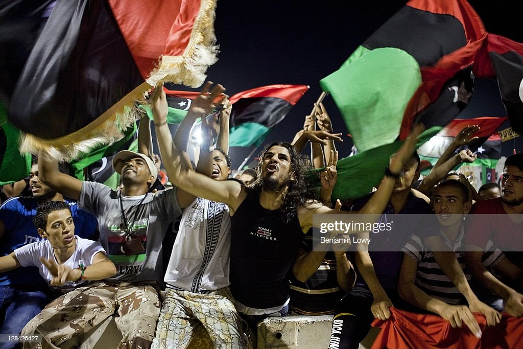 Libyans celebrate the fall of Libyan dictator Moammar Gaddafi in the the newly renamed Martyr's Square on August 30 2011 in Tripoli, Libya.
