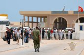 Libyans fleeing the violence in their country enter Tunisia through the southern border crossing at Ras Jedir on July 30 2014 Tunisia cannot cope...