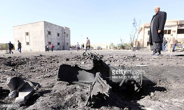 TOPSHOT Libyans inspect the site of a suicide truck bombing on a police school in Libya's coastal city of Zliten some 170 kilometres east of the...