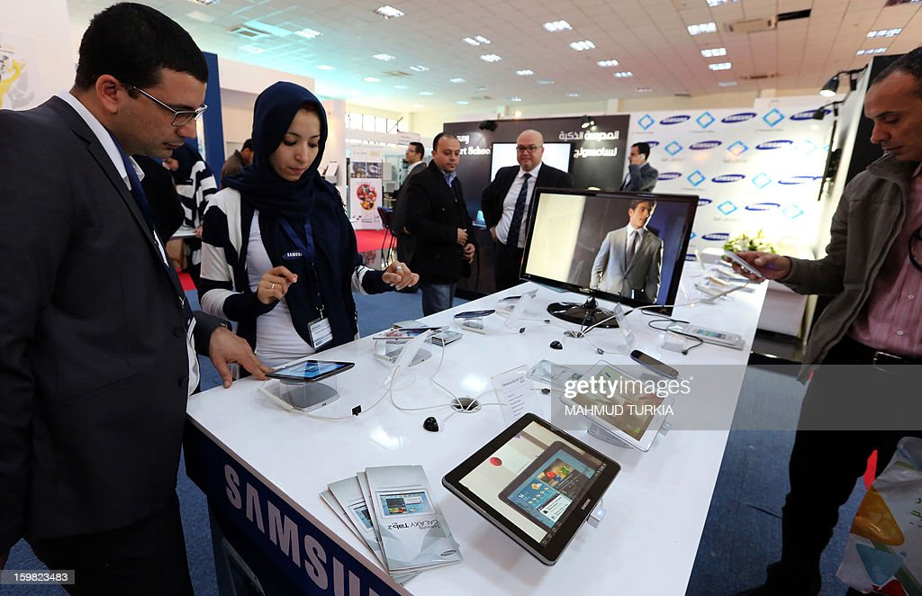 Libyans peruse electronic tablets during the opening of the seventh annual exhibition for Communications and Information Technology in the Libyan capital Tripoli, on January 21, 2013.