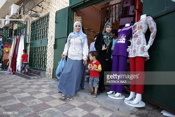 Libyans shop for the upcoming Eid alFitr holiday which marks the end of the holy fasting month of Ramandan in Tripoli on August 28 as Libyan rebels...