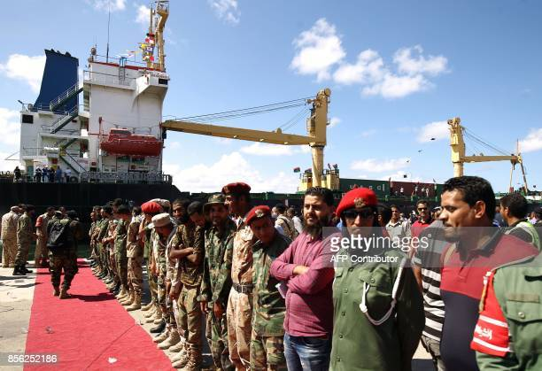 Libyans stand in line at the Benghazi port which was closed for the past three years due to rebel groups occupying the eastern Libyan city during a...