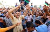 Libyans take part in a demonstration in the capital Tripoli on July 31 calling for international intervention to protect civilians Tripoli warned of...